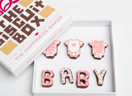 pink baby vest biscuits by The Biscuit Box